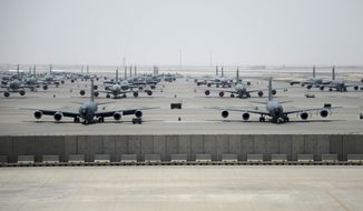 U.S. Air Force KC-135 Stratotankers sit on the ramp of the 379th Air Expeditionary Wing at Al Udeid Air Base, Qatar, on Aug. 19, 2017. The 379th AEW is the largest, most diverse expeditionary wing in the Air Force, operating more than 100 aircraft. (U.S. Air National Guard photo by Master Sgt. Andrew J. Moseley/Released)