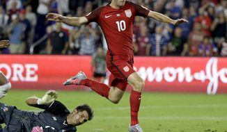 United States' Christian Pulisic (10) gets past Panama goalkeeper Jaime Penedo (1) to score a goal during the first half of a World Cup qualifying soccer match, Friday, Oct. 6, 2017, in Orlando, Fla. (AP Photo/John Raoux)