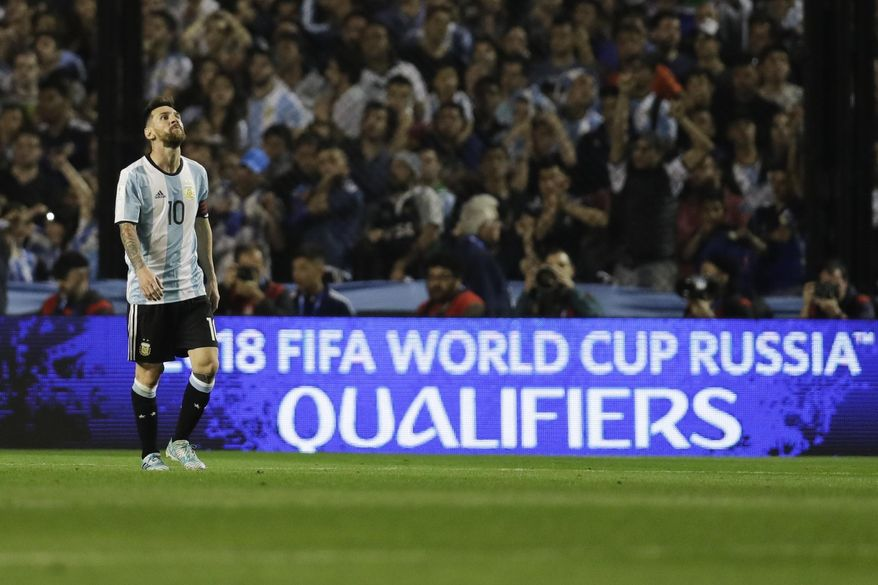 Argentina's Lionel Messi walks on the pitch during a World Cup qualifying soccer match against Peru at La Bombonera stadium in Buenos Aires, Argentina, Thursday, Oct. 5, 2017. Argentina tied the match 0-0 and is almost eliminated from the upcoming World Cup in Russia. (AP Photo/Victor R. Caivano)