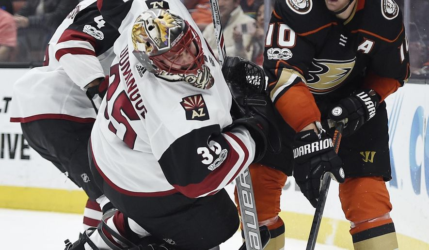 Anaheim Ducks right wing Corey Perry, right, trips Arizona Coyotes goalie Louis Domingue resulting in a goalie interference penalty during the second period of an NHL hockey game in Anaheim, Calif., Thursday, Oct. 5, 2017. (AP Photo/Kelvin Kuo)
