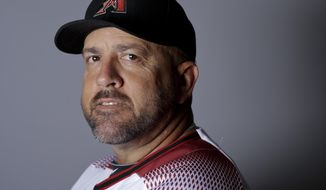 """FILe - This is a 2016 file photo showing Ariel Prieto of the Arizona Diamondbacks baseball team. Diamondbacks coach Ariel Prieto says it was a mistake for him to wear an Apple Watch in the dugout during the NL wild-card game against Colorado. Prieto told reporters on Thursday, Oct. 5, 2017,  that he didn't use the watch for any illicit purpose and that it was on """"airplane mode"""" during the game, a setting that shuts off any of the watch's communication abilities. (AP Photo/Chris Carlson, File)"""