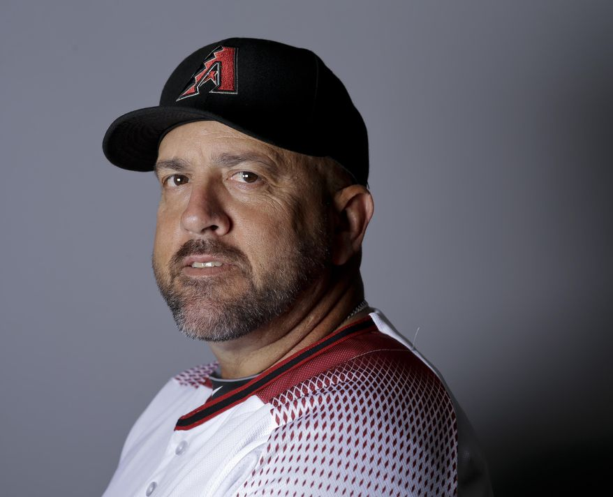 "FILe - This is a 2016 file photo showing Ariel Prieto of the Arizona Diamondbacks baseball team. Diamondbacks coach Ariel Prieto says it was a mistake for him to wear an Apple Watch in the dugout during the NL wild-card game against Colorado. Prieto told reporters on Thursday, Oct. 5, 2017,  that he didn't use the watch for any illicit purpose and that it was on ""airplane mode"" during the game, a setting that shuts off any of the watch's communication abilities. (AP Photo/Chris Carlson, File)"