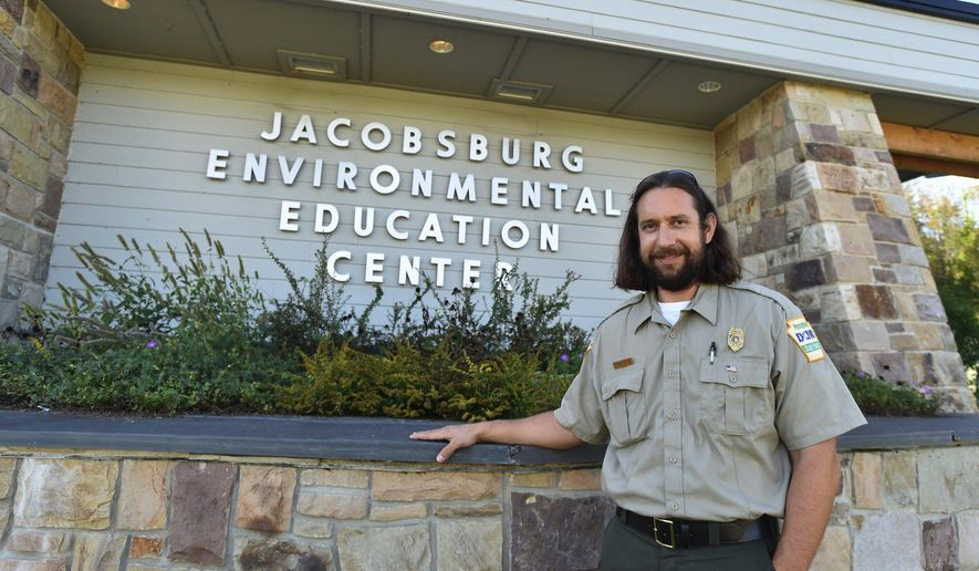 Jacobsburg Environmental Education Center Manger Rob Neitz poses in front of the Jacobsburg Environmental Education Center located at Belfast Rd, Nazareth, Pa. Pennsylvania State park users keep climbing, and the state is trying to survey all these people to meet their needs. (April Gamiz/The Morning Call via AP)
