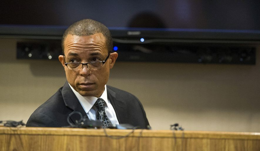 Harvey Hollins, director of urban initiatives for the state of Michigan, testifies on the fourth day of Michigan Health and Human Services Director Nick Lyon's preliminary examination on Friday, Oct. 6, 2017, in Genesee County District Court in Flint, Mich. Lyon faces charges of involuntary manslaughter and misconduct in office for his response to the Flint Water Crisis. His court proceedings have progressed farther than those of other public officials facing criminal charges in connection to the crisis. Lyon's exam was conducted in front of Judge David J. Goggins. (Terray Sylvester /The Flint Journal-MLive.com via AP)