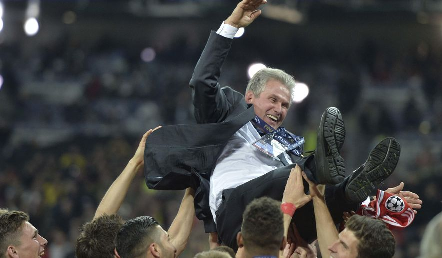 FILE - In this May 25, 2013 file photo then Bayern Munich head coach Jupp Heynckes is thrown in the air by his players after winning the Champions League Final soccer match against Borussia Dortmund at Wembley Stadium in London. (AP Photo/Martin Meissner)