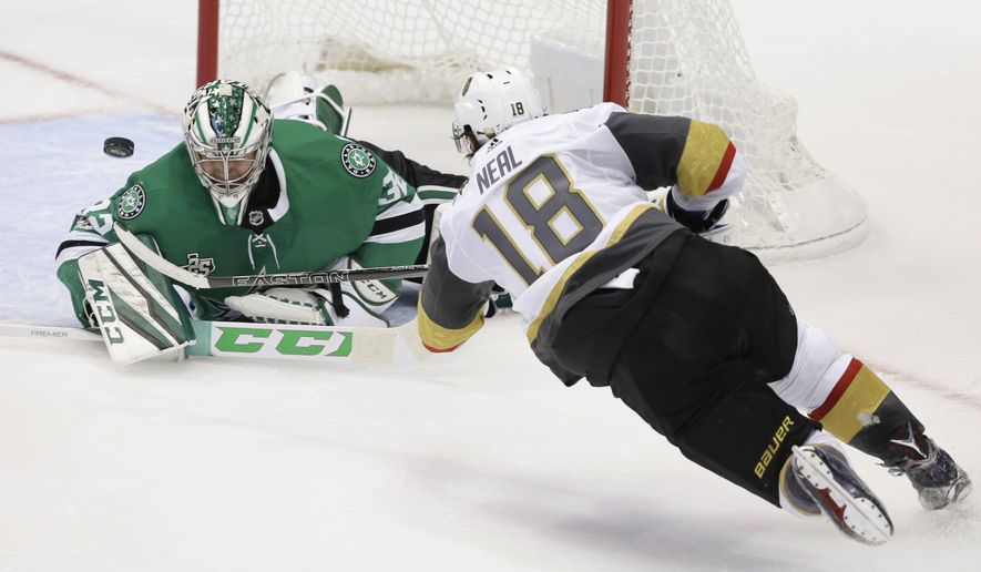 Vegas Golden Knights left wing James Neal (18) scores a goal against Dallas Stars goalie Kari Lehtonen (32) during the third period of an NHL hockey game in Dallas, Friday, Oct. 6, 2017. The Golden Knights won 2-1. (AP Photo/LM Otero)