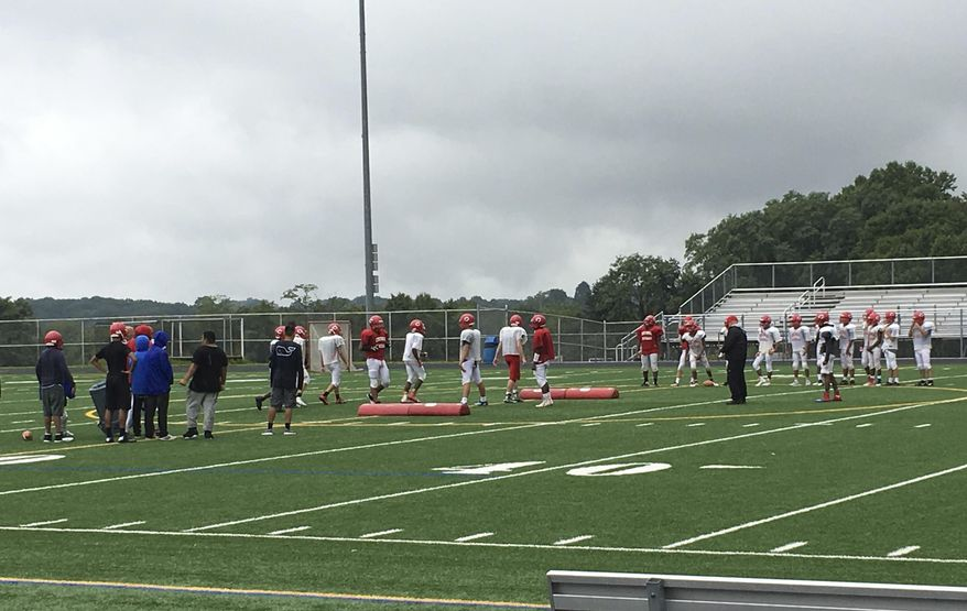 Members of the Centennial High School junior varsity football team practice at the school's varsity stadium in Ellicott City, Md., Wednesday, Sept. 6, 2017. Centennial decided not to field a varsity team this year because not enough boys wanted to play. Nationwide, participation in high school football is declining, in part because of concerns about head injuries. (AP Photo/Ben Nuckols)