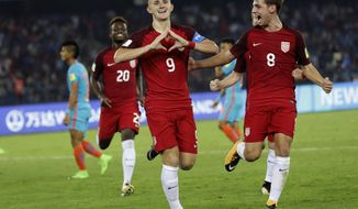 U.S. soccer player Josh Sargent celebrates a goal against India during their FIFA U-17 World Cup match in New Delhi, India, Friday, Oct. 6, 2017. (AP Photo/Tsering Topgyal)