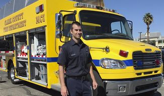 Clark County Fire Department engineer Brian Emery stands by one of his agency's Mass Casualty Incident vehicles in Las Vegas on Thursday, Oct. 5, 2017. Emery was driving a traditional fire engine the night of the shooting when his crew wound up being among the first on duty emergency workers to arrive at the scene on Sunday. The four members of the crew treated some 30 people with a range of injuries from shortly after 10 p.m. until after sunrise Monday. A gunman opened fire on an outdoor country music concert on Sunday killing dozens and injuring hundreds. (AP Photo/Anita Snow)