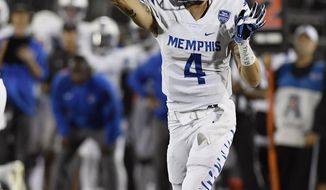 Memphis quarterback Riley Ferguson throws during the first half of an NCAA college football game against Connecticut, Friday, Oct. 6, 2017, in East Hartford, Conn. (AP Photo/Jessica Hill)