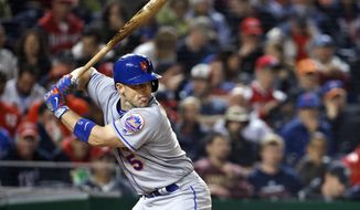 FILE - In this May 23, 2016, file photo, New York Mets' David Wright bats during the fifth inning of a baseball game against the Washington Nationals at Nationals Park in Washington. Wright underwent back surgery, his second operation in a month as he tries to return to the major leagues after an absence of 1 1/2 years. The team said Thursday, Oct. 5, 2017, that Wright had a procedure in Los Angeles called a laminotomy, which is a treatment for nerve compression in the spinal canal. (AP Photo/Alex Brandon, File)