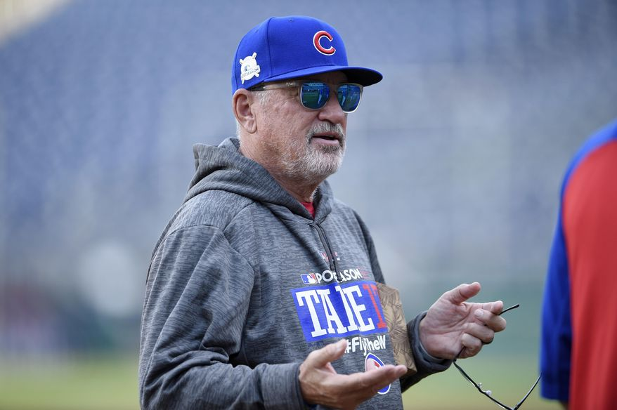 Chicago Cubs manager Joe Maddon gestures on the field during practice at Nationals Park, Thursday, Oct. 5, 2017, in Washington. Game 1 of the National League Division Series against the Washington Nationals is on Friday. (AP Photo/Nick Wass)
