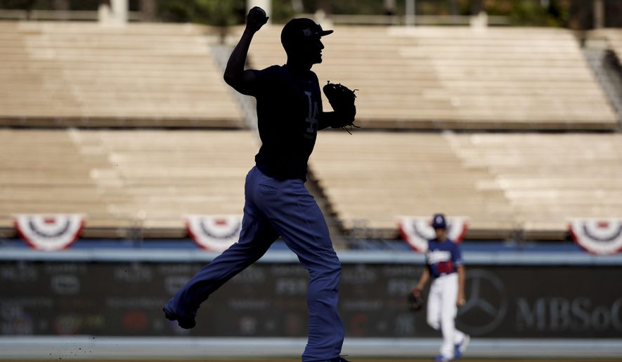 Los Angeles Dodgers shortstop Corey Seager throws during batting practice before Game 1 of the baseball team's National League Division Series against the Arizona Diamondbacks in Los Angeles, Friday, Oct. 6, 2017. (AP Photo/Jae C. Hong)