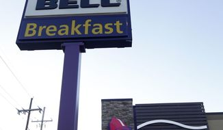 FILE - This Dec. 15, 2016, file photo shows a Taco Bell restaurant in Metairie, La. Robert L. McKay, who designed the first Taco Bell restaurant and with founder Glenn Bell turned it from a quirky food stand into a fast-food empire, died last week. He was 86. (AP Photo/Gerald Herbert, File)