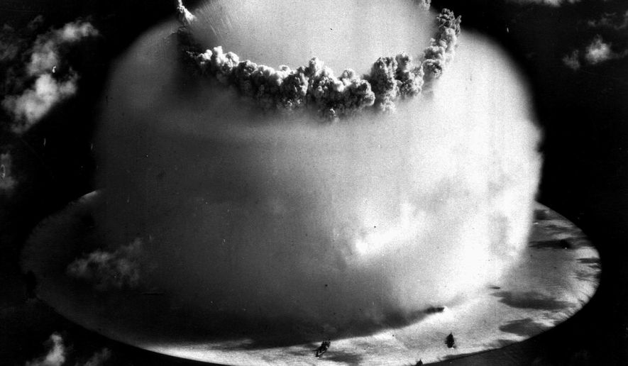 "FILE - In this July 25, 1946 file photo, a huge mushroom cloud rises above Bikini atoll in the Marshall Islands following an atomic test blast, part of the U.S. military's ""Operation Crossroads."" Bikini Atoll in the Marshall Islands remains contaminated by radiation, part of a troubling nuclear testing legacy that continues to affect islands and people across the Pacific long after the U.S., Britain and France stopped their testing programs there. (AP Photo, File)"