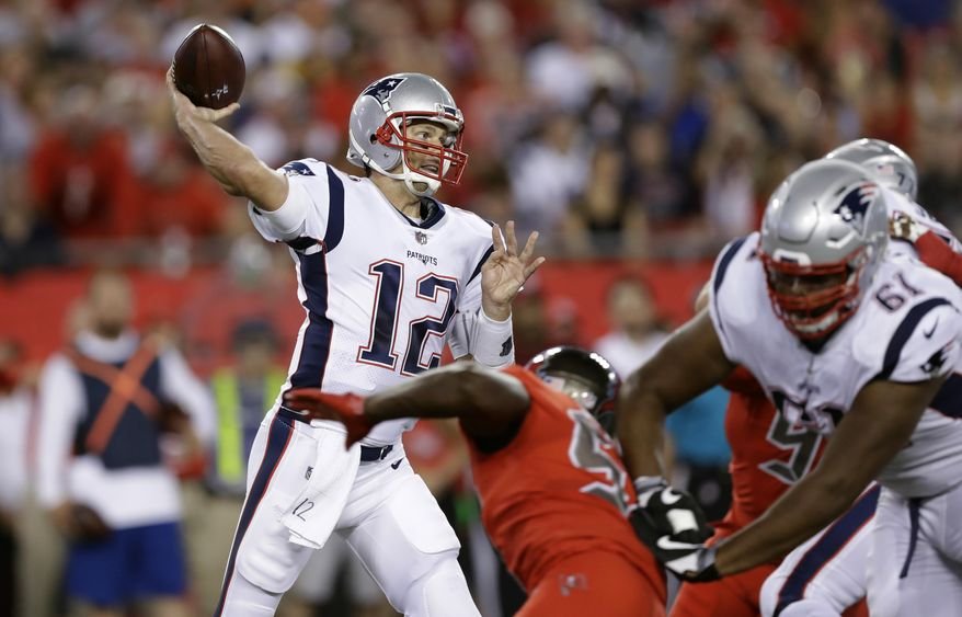 New England Patriots quarterback Tom Brady (12) throws a pass against the Tampa Bay Buccaneers during the first quarter of an NFL football game Thursday, Oct. 5, 2017, in Tampa, Fla. (AP Photo/Chris O'Meara)