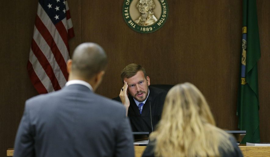 Judge Chris Lanese talks with attorneys during a scheduling hearing in Thurston County Superior Court in Olympia, Wash., for a lawsuit against the Washington Legislature brought by a coalition of news organizations, and led by The Associated Press, on Friday, Oct. 6, 2017.  The suit challenges lawmakers' claim that the state's public records law excludes them from stricter disclosure rules that apply to other elected officials and agencies. (AP Photo/Ted S. Warren)