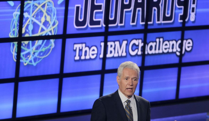 """FILE - In this Jan. 13, 2011, file photo, Alex Trebek, host of the """"Jeopardy!"""" quiz show, speaks to an audience of primarily media about an upcoming """"Jeopardy!"""" show featuring IBM's """"Watson"""" in Yorktown Heights, N.Y. New York City bartender Austin Rogers extended his run of wins to eight on the show that aired Oct. 5, 2017, and boosted his total winnings to more than $300,000. Rogers' on-screen antics are winning him a cult following. (AP Photo/Seth Wenig, File)"""