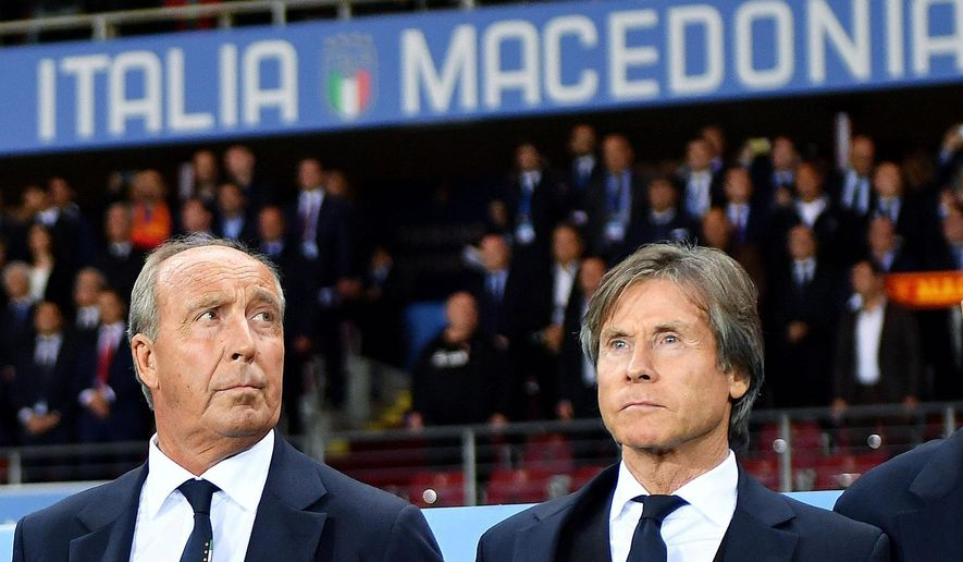 Italy coach Gian Piero Ventura, left, waits for the start of a World Cup Group G qualifying soccer match between Italy and Macedonia in Turin, Italy, Friday, Oct. 6, 2017. (Alessandro Di Marco/ANSA via AP)