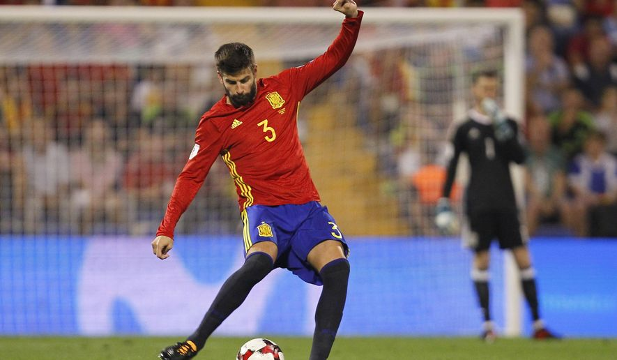 Spain's Gerard Pique kicks the ball during the World Cup Group G qualifying soccer match between Spain and Albania at the Rico Perez stadium in Alicante, Spain, Friday, Oct. 6, 2017. (AP Photo/Alberto Saiz)