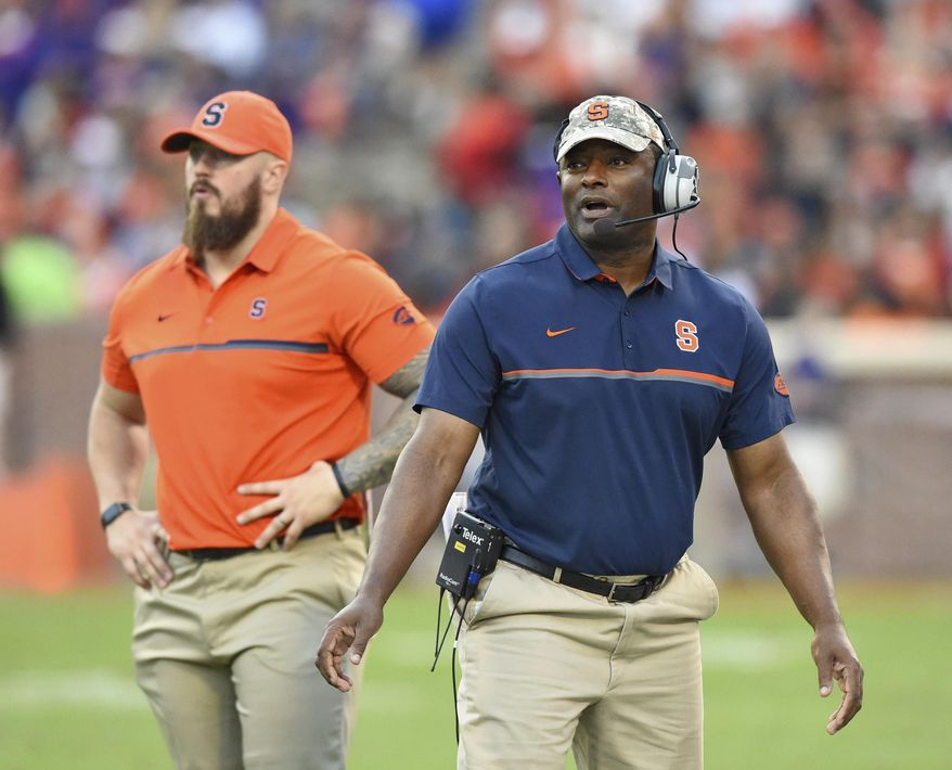 FILE - In this Nov. 5, 2016, file photo, Syracuse head coach Dino Babers reacts during the second half of an NCAA college football game against Clemson, in Clemson, S.C. Babers is still waiting for that breakthrough, when his Orange put everything together for an extended period of time. They've shown that his system can work wonders, but only in fits and spurts.  (AP Photo/Richard Shiro, File)