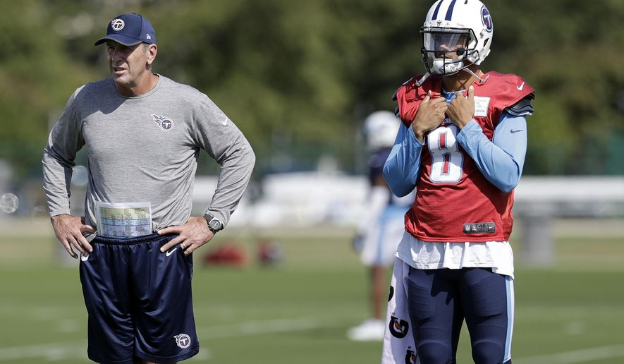 Tennessee Titans head coach Mike Mularkey and quarterback Marcus Mariota (8) watch during NFL football practice Wednesday, Oct. 4, 2017 in Nashville, Tenn. The status for Mariota, limited the past two days in practice by a strained hamstring, might not be decided until shortly before kickoff Sunday for the Titans' game against Miami. (AP Photo/Mark Humphrey)