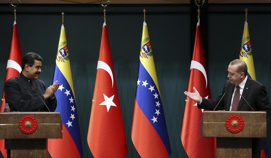 Turkey's President Recep Tayyip Erdogan, right, gestures to Venezuela's President Nicolas Maduro during a joint media statement following their meeting at the Presidential Palace in Ankara, Turkey, Friday, Oct. 6, 2017. Erdogan said his country does not condone any external interventions in South America after meeting with Maduro, on the first by a Venezuelan head of state official visit to Ankara, than comes amid stringent U.S. sanctions on the South American nation.(Yasin Bulbul/Presidency Press Service, Pool Photo via AP)