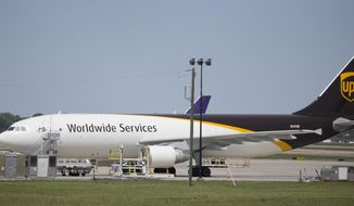 In this Tuesday, April 18, 2017 photo, a United Parcel Service cargo plane sits idle during the day as it awaits loading at Richmond International Airport in Sandston, Va..  UPS says in court records that it suspects one of its pilots obtained secret business plans for the shipping giant's aircraft fleet and posted them online. In a federal lawsuit filed the  week of Oct. 6, 2017, UPS says its strategic plans are highly confidential, and says a PowerPoint presentation was intended only for senior executives.(AP Photo/Steve Helber)