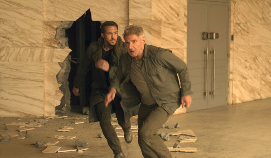 """This image released by warner Bros. Pictures shows Ryan Gosling, left, and Harrison Ford in a scene from """"Blade Runner 2049."""" (Stephen Vaughan/Warner Bros. Pictures via AP)"""
