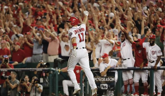Washington Nationals' Ryan Zimmerman pumps his fist in the air after hitting a three-run home run off Chicago Cubs relief pitcher Mike Montgomery (38) during the eighth inning in Game 2 of baseball's National League Division Series, at Nationals Park, Saturday, Oct. 7, 2017, in Washington. (AP Photo/Pablo Martinez Monsivais)