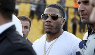In March 13, 2015, file photo, rapper Nelly approaches the stage for a concert in Irbil, northern Iraq. On Dec. 14, 2017, prosecutors in King County, Wash., dismissed sex-assault charges against the musician after the alleged victim of an Oct. 7 rape declined to assist in the investigation, People magazine reported.  (AP Photo/Seivan M. Salim, File)