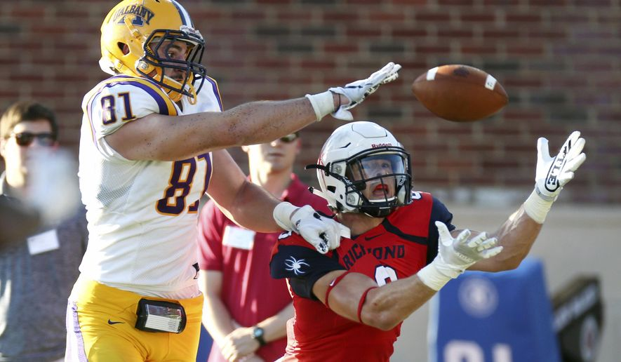 Richmond's Gordon Collins reaches out for a catch while Albany's Brian Dolce breaks it up during during an NCAA college football game in Richmond, Va., Saturday, Oct. 7, 2017.  game on Oct. 7, 2017. (Shelby Lum/Richmond Times-Dispatch via AP)