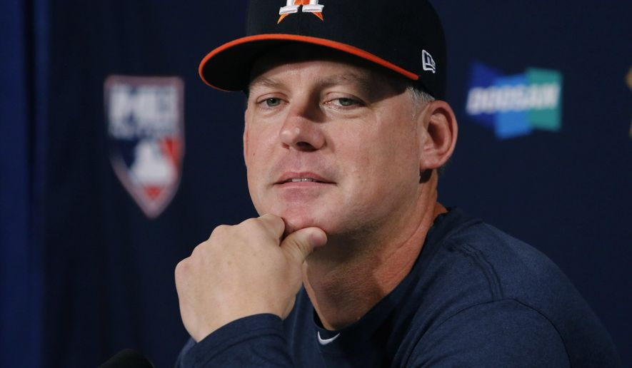 Houston Astros manager A.J. Hinch listens to a question during a news conference, Saturday, Oct. 7, 2017, before his team's workout as they prepare for Sunday's Game 3 of baseball's American League Division Series against the Boston Red Sox in Boston. (AP Photo/Bill Sikes)
