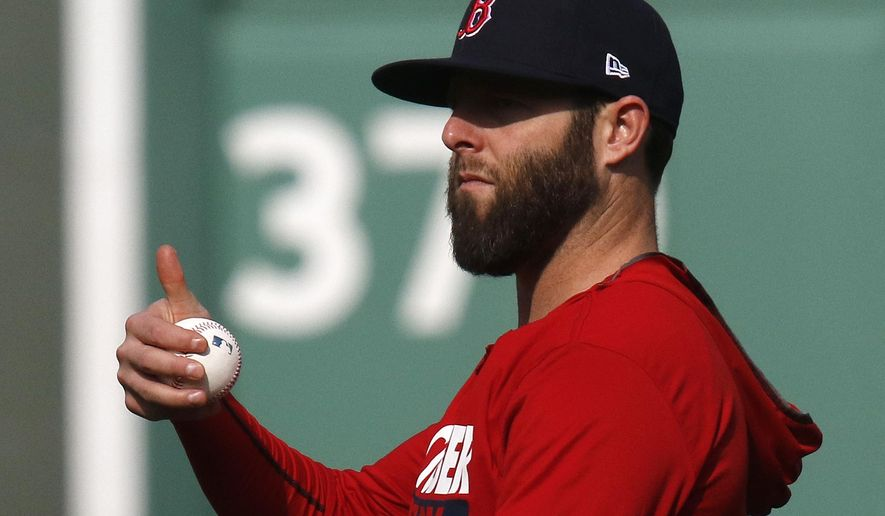 Boston Red Sox second baseman Dustin Pedroia gives a thumbs-up during a workout, Saturday, Oct. 7, 2017, as the team prepares for Sunday's Game 3 of baseball's American League Division Series against the Houston Astros in Boston. (AP Photo/Bill Sikes)