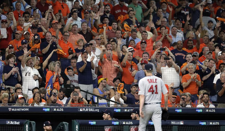 Fans react as Boston Red Sox starting pitcher Chris Sale (41) is pulled from the baseball game in the sixth inning in Game 1 against the Houston Astros on an American League Division Series, Thursday, Oct. 5, 2017, in Houston. (AP Photo/David J. Phillip)