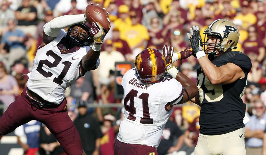 Minnesota's Kamal Martin intercepts a pass intended for Purdue's Brycen Hopkins of Purdue in the second quarter during an NCAA college football game against Minnesota, Saturday, Oct. 7, 2017, in West Lafayette, Ind. (John Terhune/Journal & Courier via AP)