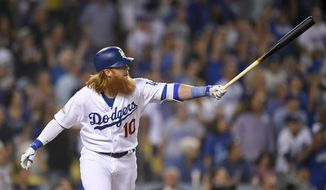 Los Angeles Dodgers' Justin Turner watches his three-run home run against the Arizona Diamondbacks during the first inning of Game 1 of a baseball National League Division Series in Los Angeles, Friday, Oct. 6, 2017. (AP Photo/Mark J. Terrill)
