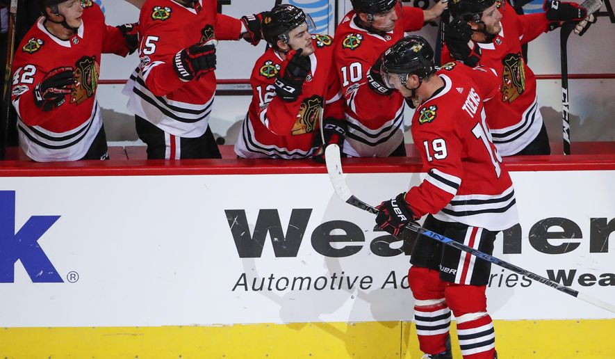 Chicago Blackhawks center Jonathan Toews (19) celebrates with teammates after scoring against the Columbus Blue Jackets during the second period of an NHL hockey game Saturday, Oct. 7, 2017, in Chicago. (AP Photo/Kamil Krzaczynski)