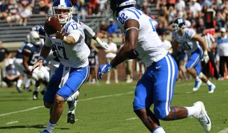 Duke's Daniel Jones (17) makes a shuffle pass to Brittain Brown (22) in the first half against Virginia Saturday, Oct. 7, 2017, in Charlottesville, Va. (Zack Wajsgras//The Daily Progress via AP)