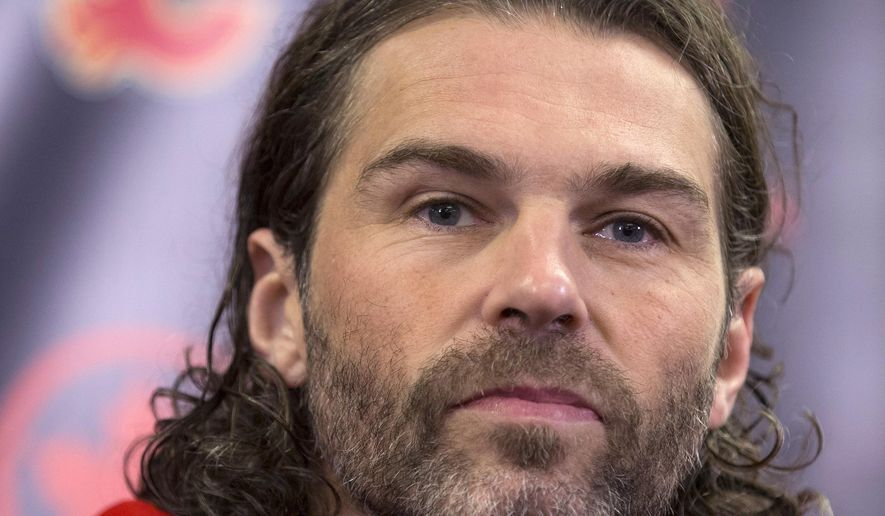 Jaromir Jagr listens to questions after being introduced as the newest Calgary Flames player at a news conference in Calgary, Alberta, Wednesday, Oct. 4, 2017.  (Larry MacDougal/The Canadian Press via AP)