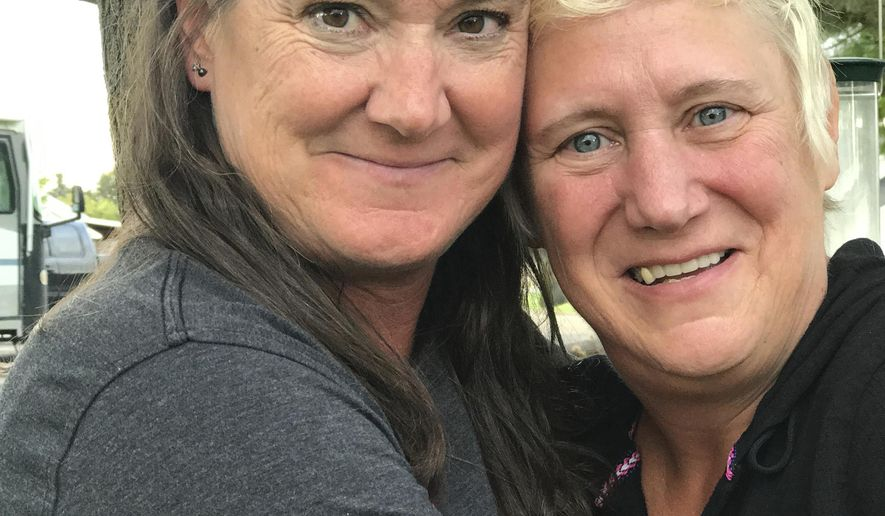 In this Tuesday, Sept. 19, 2017 photo, Mary Mendiola, left, and Myra May, who have been through nearly everything in their lives together, including each other's breast cancer diagnosis, pose for a photo during an interview in Nampa, Idaho. (Christina Lords/The Idaho Press-Tribune via AP)