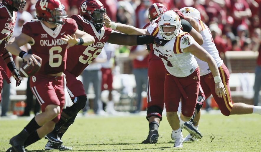 Iowa State quarterback Joel Lanning (7) is blocked by Oklahoma offensive lineman Erick Wren (58) as he chases quarterback Baker Mayfield (6) in the third quarter of an NCAA college football game in Norman, Okla., Saturday, Oct. 7, 2017. Iowa State won 38-31. (AP Photo/Sue Ogrocki)