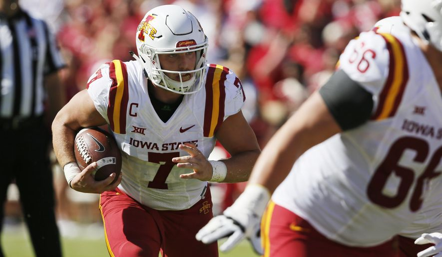 Iowa State quarterback Joel Lanning (7) carries in the first quarter of an NCAA college football game against Oklahoma in Norman, Okla., Saturday, Oct. 7, 2017. (AP Photo/Sue Ogrocki)