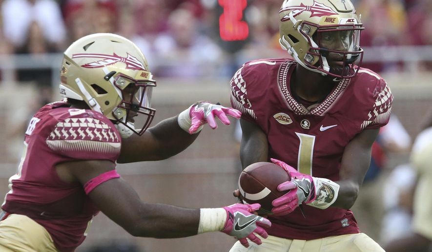 Florida State's James Blackman hands off to Cam Akers in the third quarter of an NCAA college football game with Miami, Saturday, Oct. 7, 2017, in Tallahassee, Fla. Miami won 24-20. (AP Photo/Steve Cannon)