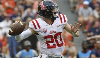 Mississippi quarterback Shea Patterson (20) releases a pass during the first half of an NCAA college football game against Auburn in Auburn, Ala., Saturday, Oct. 7, 2017. (AP Photo/Thomas Graning)