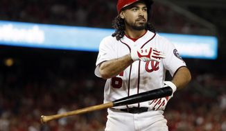 Washington Nationals' Anthony Rendon tosses his bat after a called third strike during the eighth inning in Game 1 of baseball's National League Division Series against the Chicago Cubs, at Nationals Park, Friday, Oct. 6, 2017, in Washington. (AP Photo/Alex Brandon)