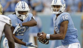 North Carolina's Jordon Brown (2) looks for the handoff while quarterback Chazz Surratt drops back in the pocket during the first half of an NCAA college football game against Notre Dame in Chapel Hill, N.C., Saturday, Oct. 7, 2017. (AP Photo/Gerry Broome)
