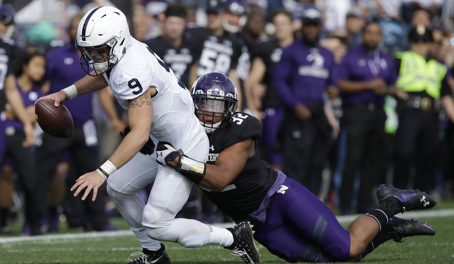 Penn State quarterback Trace McSorley, left, is tackled by Northwestern linebacker Nate Hall during the first half of an NCAA college football game in Evanston, Ill., Saturday, Oct. 7, 2017. (AP Photo/Nam Y. Huh)