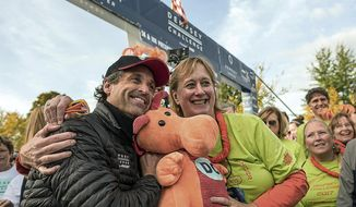 Actor Patrick Dempsey poses with Nina Houghton at the starting line of the Dempsey Challenge, a cancer fundraiser, on Saturday, Oct. 7, 2017 in Lewiston, Maine.  Dempsey created the bike-and-run Dempsey Challenge to raise money for a cancer center created in 2008 in partnership with the Central Maine Medical Center in Lewiston.  He was inspired by his mother, Amanda, who died of cancer in 2014.  (Andree Kehn/The Lewiston Sun-Journal via AP)