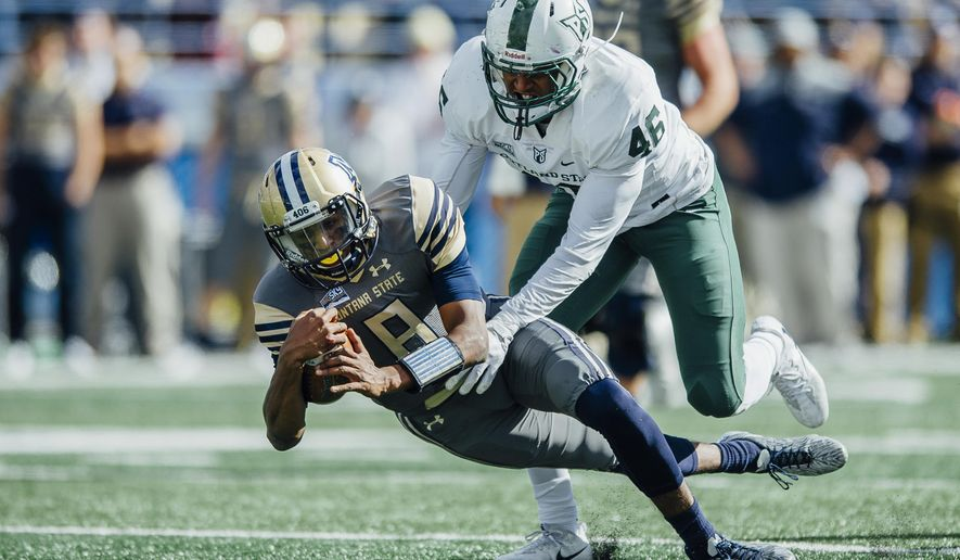 Montana State quarterback Chris Murray dives to avoid a tackle from Portland State linebacker Kasun Jackett during the first half of an NCAA college football game at Bobcat Stadium, Saturday, Oct. 7, 2017, in Bozeman, Mont. (Adrian Sanchez-Gonzalez/Montana State University via AP)